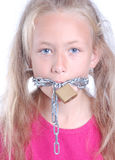 Child with chain around mouth Stock Photo