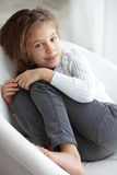 Child on a chair Royalty Free Stock Photo