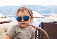 Child in chair on beach against the sea Royalty Free Stock Photography