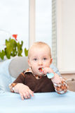 Child in chair for feeding Royalty Free Stock Photos