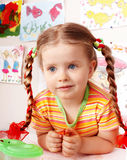 Child with chalk draw in playroom. Child with piece of chalk draw in playroom. Preschool stock images