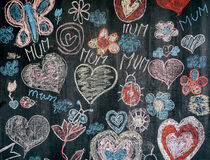Child chalk drawing on black chalkboard with congrats to mother. Day royalty free stock images