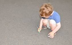 Child with chalk Stock Image