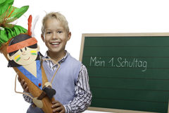 Child beside chalkboard having first schoolday Stock Photo