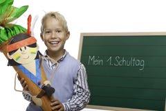 Child beside chalkboard having first schoolday Stock Photo