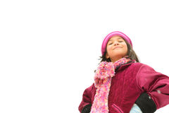 Child with challenging expression. Standing outdoors in winter royalty free stock photos
