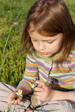 Child with chamomile. Little girl with chamomile outdoors Stock Photography
