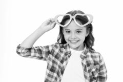 Child charming smile fall in love. Girl heart shaped eyeglasses celebrates valentines day. Girl cute kid smiling face. Heart eyeglasses. Love symbol concept stock images