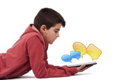 Child chatting. With graphics tablet posts royalty free stock images