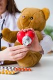 The child checking soft toy health Royalty Free Stock Photography