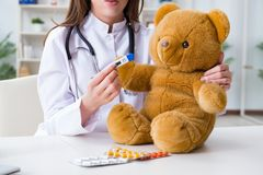 The child checking soft toy health. Child checking soft toy health Stock Image