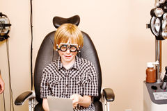 Child checking vision using specialized glasses Stock Photos