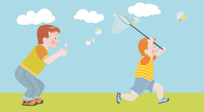 He child cheerfully catches a net soap bubbles Stock Photo