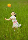 Child cheerfully plays with ball stock images