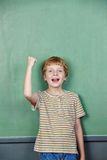 Child cheering in front Royalty Free Stock Photo