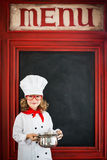 Child chef cook. Restaurant business concept Stock Photography