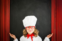 Child chef cook. Restaurant business concept Royalty Free Stock Photos