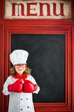 Child chef cook. Restaurant business concept Stock Photo