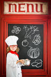 Child chef cook. Restaurant business concept Stock Photos