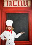 Child chef cook. Restaurant business concept Stock Image