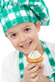 Child with chef hat holding muffin Royalty Free Stock Images