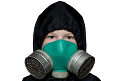 The child in the chemical protection suit Stock Image