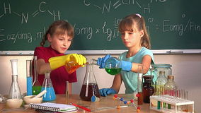 Child in chemistry class. stock video