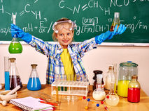 Child in chemistry class. Stock Image
