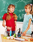 Child in chemistry class. Royalty Free Stock Images