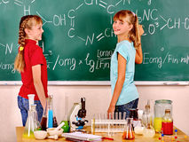 Child in chemistry class Stock Image