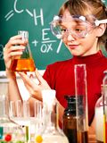 Child in chemistry class. Stock Images