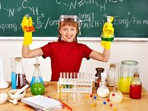 Child in chemistry class. Royalty Free Stock Photography