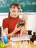 Child in chemistry class. Royalty Free Stock Photo