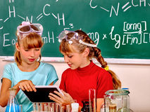 Child in chemistry class Royalty Free Stock Image