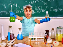 Child in chemistry class Royalty Free Stock Photos