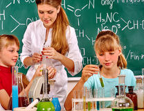 Child in chemistry class royalty free stock photography