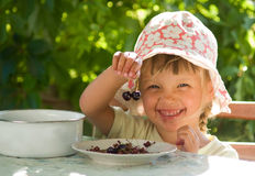Child with cherries. Girl holding last pair of cherries Royalty Free Stock Images