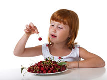 Child with cherry Stock Image
