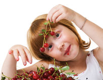 Child with cherry Stock Images