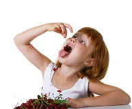 Child with cherry Royalty Free Stock Photos