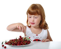 Child with cherry Stock Photo