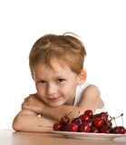Child with cherry Royalty Free Stock Image