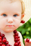 Child with cherry beads Royalty Free Stock Photo