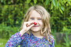 Child with cherry in the hand Royalty Free Stock Image