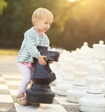 Child with chess figures outdoor Royalty Free Stock Photos