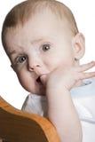 Child chew finger Stock Image