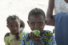 Child chewing mango, Guinea Bissau Royalty Free Stock Image
