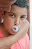 Child with chewing gum royalty free stock image