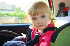 Child in a child seat car Royalty Free Stock Photography