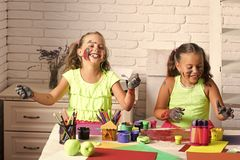 Child Childhood Children Happiness Concept. Arts and crafts. Kids learning and playing. Children happy smiling with colored hands. Imagination, creativity and royalty free stock images